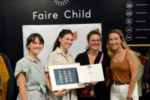 Faire Child receiving the Milk Award in the 'Green' category, summer 2019